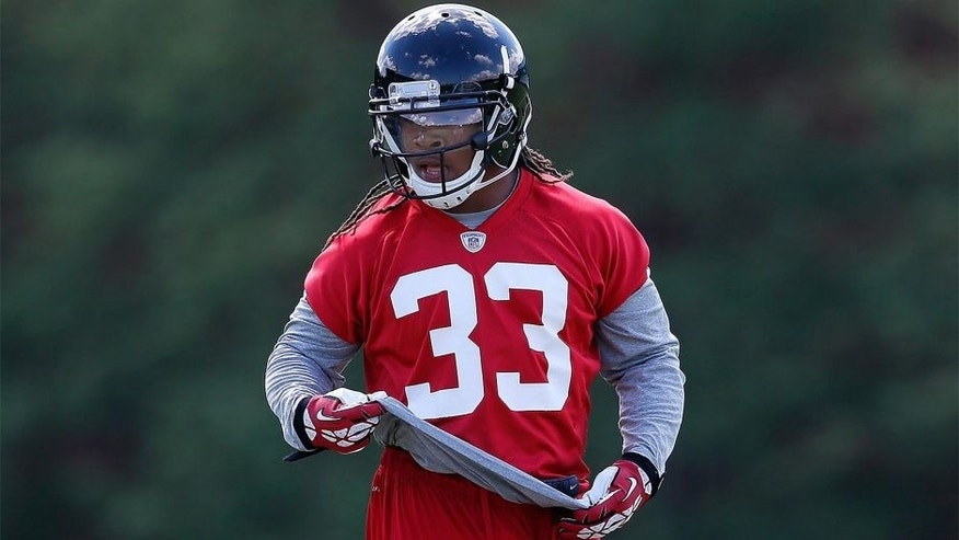 FLOWERY BRANCH, GA - MAY 16: Rookie running back Devonta Freeman #33 of the Atlanta Falcons runs drills during rookie minicamp at the Atlanta Falcons Training Facility on May 16, 2014 in Flowery Branch, Georgia. (Photo by Kevin C. Cox/Getty Images)