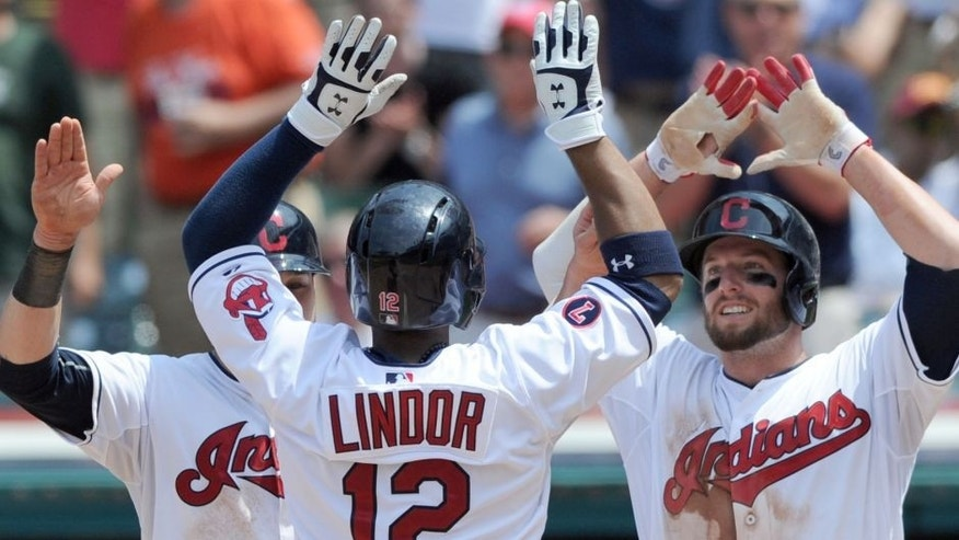 Jul 29, 2015; Cleveland, OH, USA; Cleveland Indians shortstop Francisco Lindor (12) celebrates with Indians left fielder Tyler Holt (13) and second baseman Jason Kipnis (22) after hitting a three-run home run during the sixth inning against the Kansas City Royals at Progressive Field.