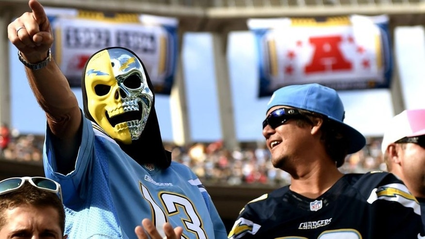 SAN DIEGO, CA - OCTOBER 19: San Diego Chargers fans cheer for their team during the NFL football game against Kansas City Chiefs at Qualcomm Stadium on October 19, 2014, in San Diego, California. (Photo by Kevork Djansezian/Getty Images)