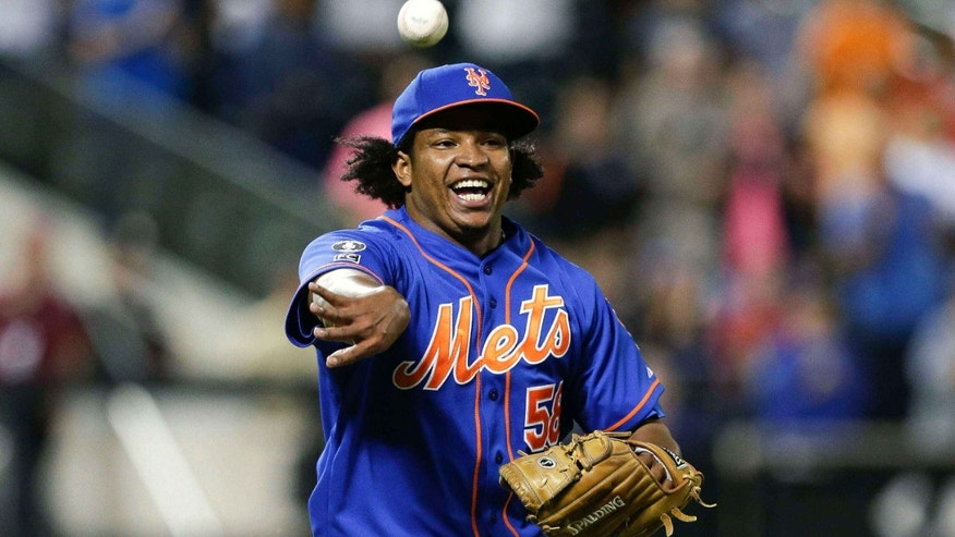 Sept. 10, 2014: New York Mets relief pitcher Jenrry Mejia tosses the ball to throw out Colorado Rockies' Josh Rutledge at first base to end a baseball game, in New York.