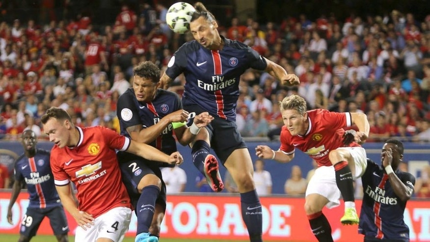 CHICAGO, IL - JULY 29: Phil Jones and Bastian Schweinsteiger of Manchester United in action with Thiago Silva and Zlatan Ibrahimovic of Paris Saint Germain during the International Champions Cup 2015 match between Manchester United and Paris Saint Germain at Soldier Field on July 29, 2015 in Chicago, Illinois. (Photo by Tom Purslow/Man Utd via Getty Images)