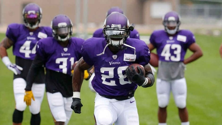 Tuesday, July 28: Minnesota Vikings running back Adrian Peterson leads his teammates in a drill during the first practice in full pads at training camp on the campus of Minnesota State University in Mankato.