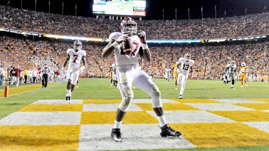 Oct 25, 2014; Knoxville, TN, USA; Alabama Crimson Tide running back Derrick Henry (27) celebrates after rushing for a touchdown against the Tennessee Volunteers during the second half game at Neyland Stadium. Alabama won 34-20. Mandatory Credit: Jim Brown-USA TODAY Sports