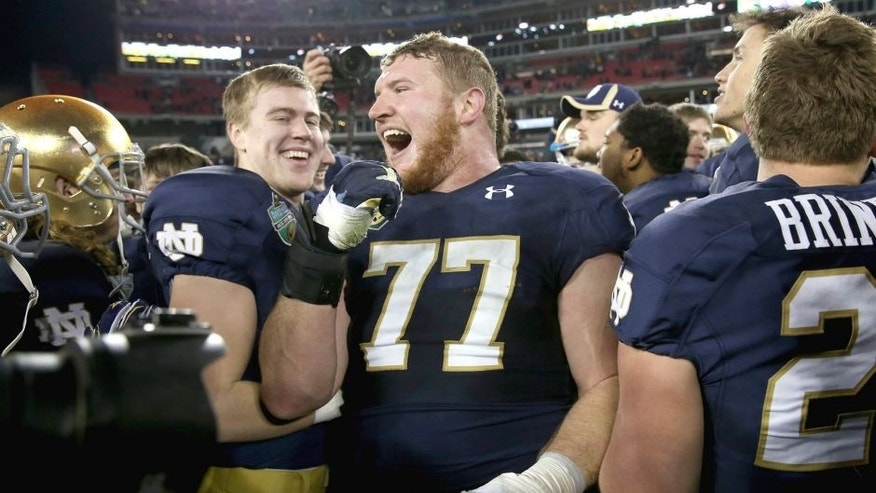 NASHVILLE, TN - DECEMBER 30: Matt Hegarty #77 of the Notre Dame Fighting Irish celebrates after beating the LSU Tigers in the Franklin American Mortgage Music City Bowl at LP Field on December 30, 2014 in Nashville, Tennessee. (Photo by Andy Lyons/Getty Images)