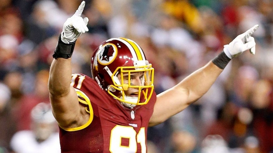Dec 20, 2014; Landover, MD, USA; Washington Redskins outside linebacker Ryan Kerrigan (91) celebrates after Philadelphia Eagles kicker Cody Parkey (1) misses a field goal in the third quarter at FedEx Field. The Redskins won 27-24. Mandatory Credit: Geoff Burke-USA TODAY Sports