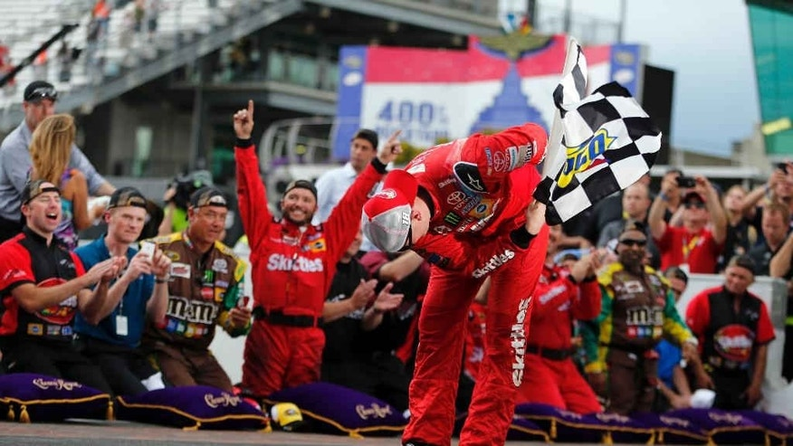Kyle Busch celebrates after winning the NASCAR Brickyard 400 auto race at Indianapolis Motor Speedway in Indianapolis, Sunday, July 26, 2015. (AP Photo/AJ Mast)