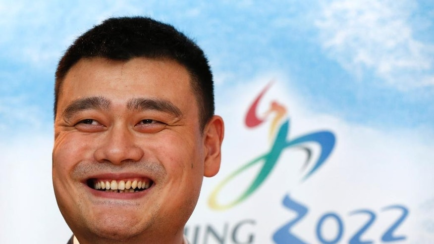 Yao Ming, retired Chinese professional basketball player smiles during a press conference for Beijing 2022 Olympic bid in Kuala Lumpur, Malaysia, Wednesday, July 29, 2015. Malaysia is hosting the 128th International Olympic Committee executive board meeting where the vote for the host cities of the 2022 Olympic Winter Games and for the 2020 Youth Olympic Winter Games will take place. (AP Photo/Vincent Thian)