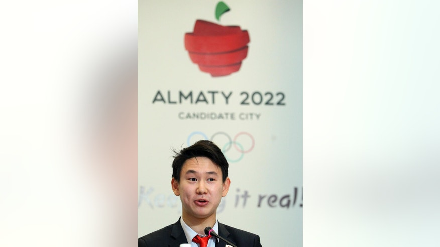 Sochi 2014 figure skating bronze medalist Denis Ten of Kazakhstan addresses a press briefing the Almaty 2022 Olympics bid in Kuala Lumpur, Malaysia, Wednesday, July 29, 2015. Malaysia is hosting the 128th International Olympic Committee executive board meeting where the vote for the host cities of the 2022 Olympic Winter Games and for the 2020 Youth Olympic Winter Games will take place. (AP Photo/Simon Yap)