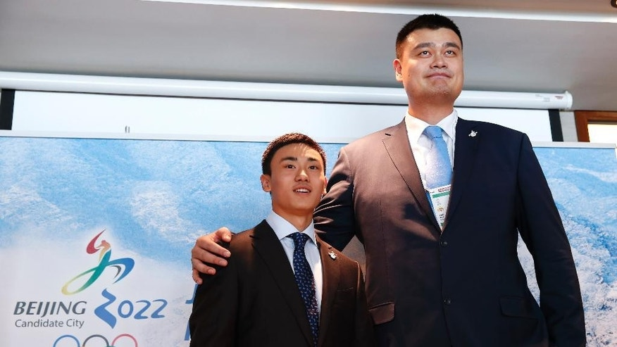 Song Andong, left, Chinese ice hockey player, poses with Yao Ming, right, retired Chinese professional basketball player during a press conference for Beijing 2022 Olympic bid in Kuala Lumpur, Malaysia,Wednesday, July 29, 2015. Malaysia is hosting the 128th International Olympic Committee executive board meeting where the vote for the host cities of the 2022 Olympic Winter Games and for the 2020 Youth Olympic Winter Games will take place. (AP Photo/Vincent Thian)