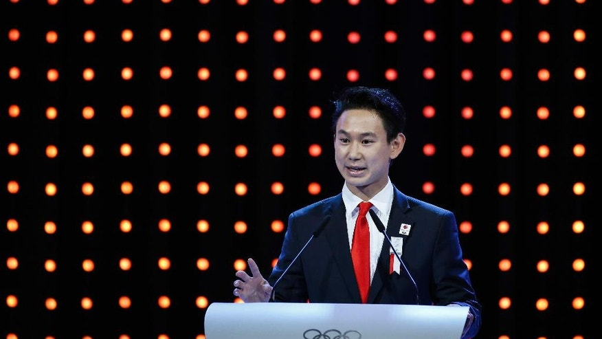 Sochi Olympic figure skating bronze medalist Denis Ten speaks during the Almaty bid presentation for the host city for the 2022 Winter Games, at the 128th International Olympic Committee session in Kuala Lumpur, Malaysia, Friday, July, 31, 2015. (AP Photo/Joshua Paul)