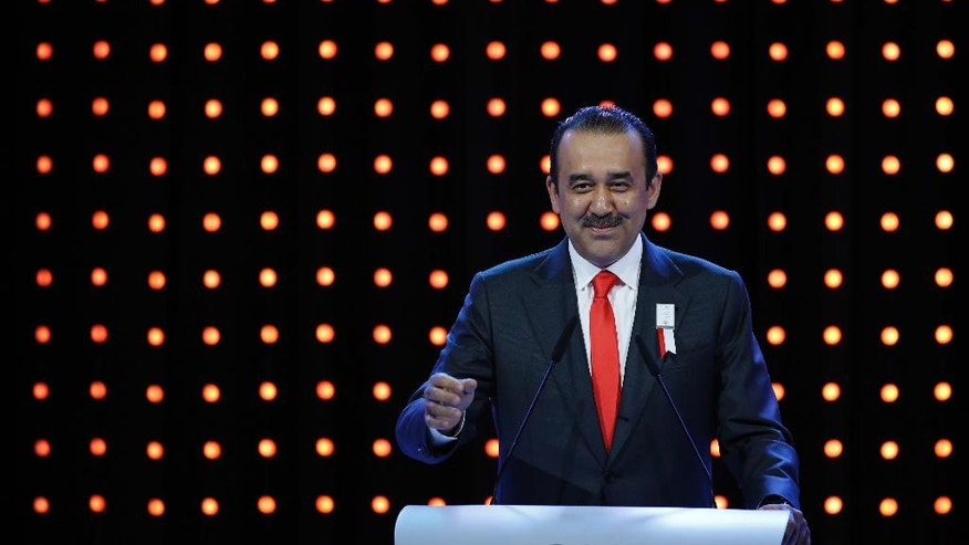 Kazakhstan's Prime Minister Karim Massimov speaks during the Almaty bid presentation for the host city for the 2022 Winter Games, at the 128th International Olympic Committee session in Kuala Lumpur, Malaysia, Friday, July, 31, 2015. (AP Photo/Joshua Paul)