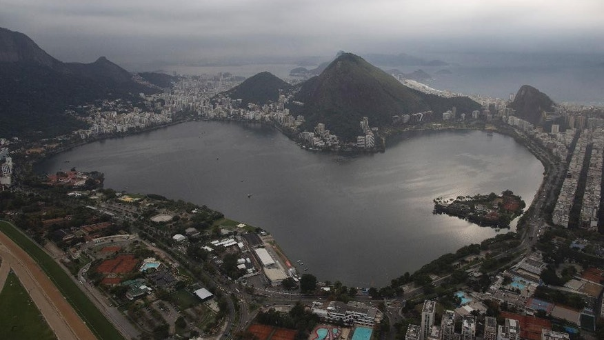 This July 27, 2015 aerial photo shows the Rodrigo de Freitas Lake in Rio de Janeiro, Brazil. An Associated Press analysis of water quality found dangerously high levels of viruses and bacteria from human sewage in Olympic and Paralympic venues. The Rodrigo de Freitas Lake, which was largely cleaned up in recent years, was thought be safe for rowers and canoers. Yet AP tests found its waters to be among the most polluted for Olympic sites. (AP Photo/Leo Correa)