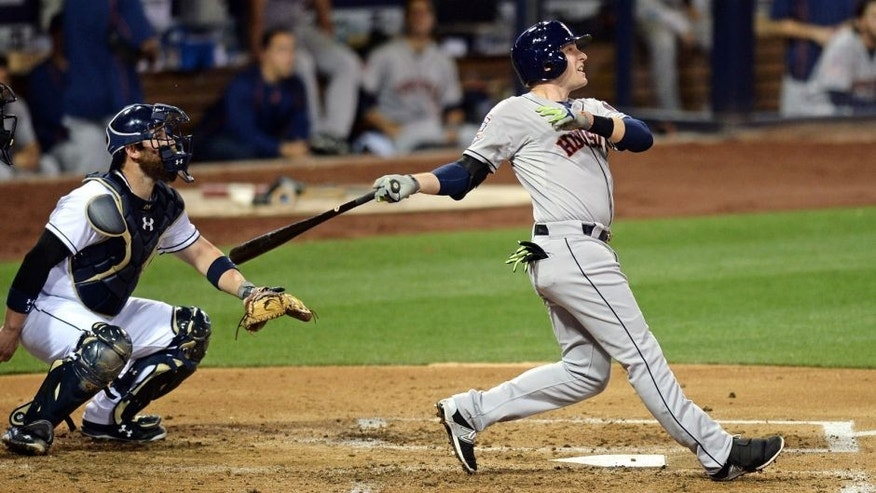 <p>Apr 27, 2015; San Diego, CA, USA; Houston Astros shortstop Jed Lowrie (right) hits a solo home run in front of San Diego Padres catcher Derek Norris (3) during the fourth inning at Petco Park. Mandatory Credit: Jake Roth-USA TODAY Sports</p>