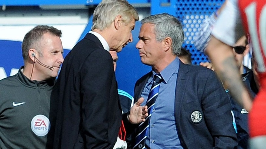 LONDON, ENGLAND - OCTOBER 05: Arsene Wenger the Arsenal Manager clashes chats with Jose Mourinho the Manager of Chelsea during the Barclays Premier League match between Chelsea and Arsenal at Stamford Bridge on October 5, 2014 in London, England. (Photo by David Price/Arsenal FC via Getty Images)