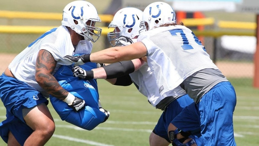 Jul 24, 2014; Anderson, IN, USA; Indianapolis Colts offensive tackle Anthony Castonzo (74) goes through blocking drills during training camp at Anderson University. Mandatory Credit: Brian Spurlock-USA TODAY Sports