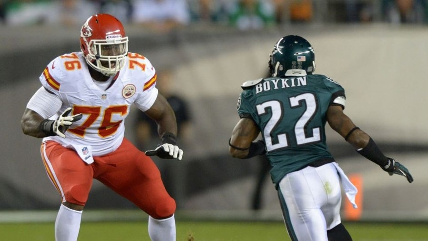 <p>Sep 19, 2013; Philadelphia, PA, USA; Kansas City Chiefs tackle Branden Albert (76) defends against Philadelphia Eagles cornerback Brandon Boykin (22) at Lincoln Financial Field. The Chiefs defeated the Eagles 26-16. Mandatory Credit: Kirby Lee-USA TODAY Sports</p>