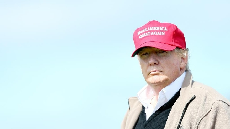 Presidential contender Donald Trump looks on at the 16th green on the 1st first day of the Women's British Open golf championship on the Turnberry golf course in Turnberry, Scotland, Thursday, July 30, 2015. (AP Photo/Scott Heppell)