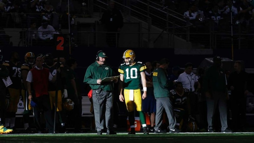 Sunday, December 15: Green Bay Packers quarterback Matt Flynn talks with head coach Mike McCarthy during the first half against the Dallas Cowboys in Arlington, Texas.