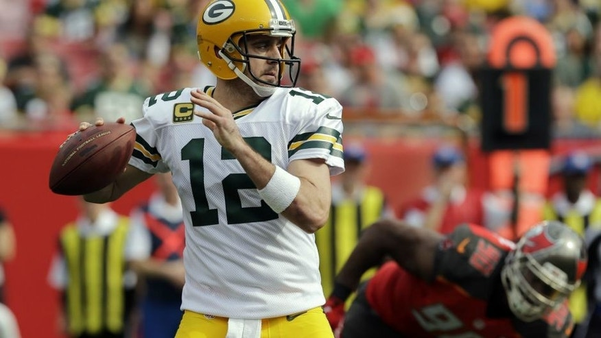 <p>Green Bay Packers quarterback Aaron Rodgers (12) throws a pass against the Tampa Bay Buccaneers during the first quarter of an NFL football game Sunday, Dec. 21, 2014, in Tampa, Fla. (AP Photo/Chris O'Meara)</p>