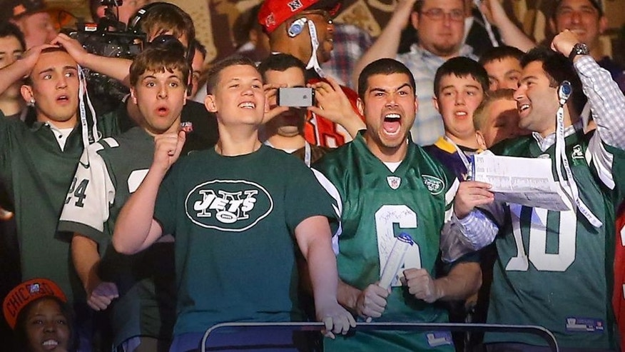 NEW YORK, NY - APRIL 25: Fans of the New York Jets react in the first round of the 2013 NFL Draft at Radio City Music Hall on April 25, 2013 in New York City. (Photo by Al Bello/Getty Images)