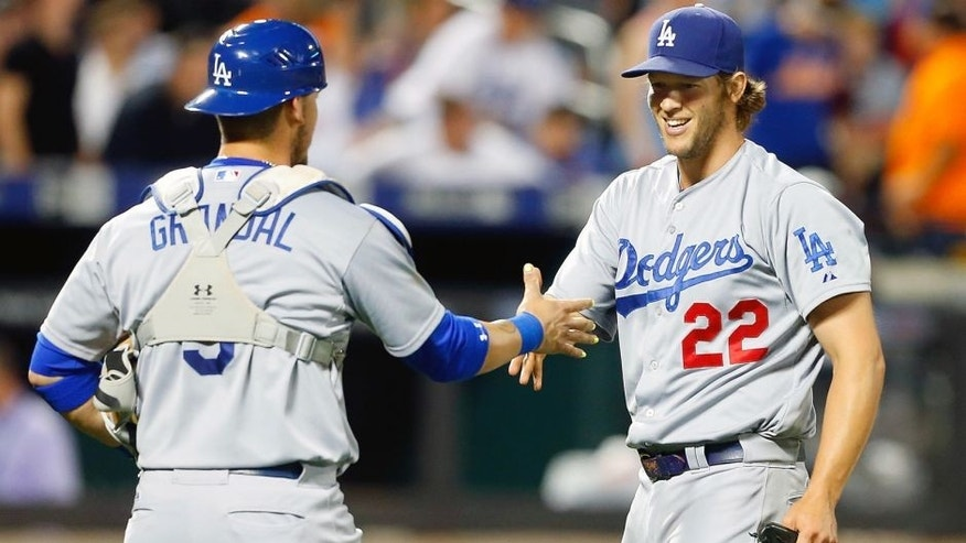 NEW YORK, NY - JULY 23: Clayton Kershaw #22 of the Los Angeles Dodgers celebrates his 3-0 shutout against the New York Mets with teammate Yasmani Grandal #9 at Citi Field on July 23, 2015 in the Flushing neighborhood of the Queens borough of New York City. (Photo by Jim McIsaac/Getty Images)