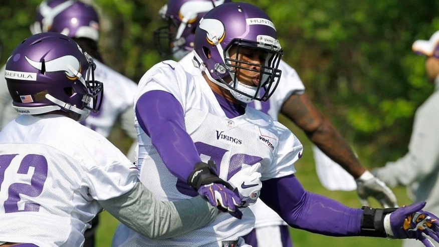 <p>Minnesota Vikings defensive end Danielle Hunter, right, takes part in a drill during NFL football rookie minicamp in Eden Prairie, Minn., Friday, May 8, 2015. (AP Photo/Ann Heisenfelt)</p>