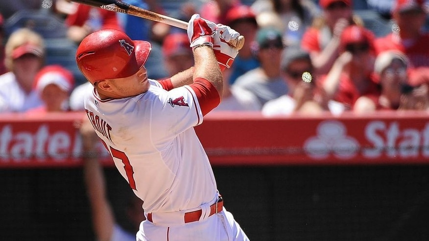 ANAHEIM, CA - JULY 26: Mike Trout #27 of the Los Angeles Angels of Anaheim follows through on a grand slam home run in the sixth inning during a game against the Texas Rangers at Angel Stadium of Anaheim on July 26, 2015 in Anaheim, California. (Photo by Jonathan Moore/Getty Images)