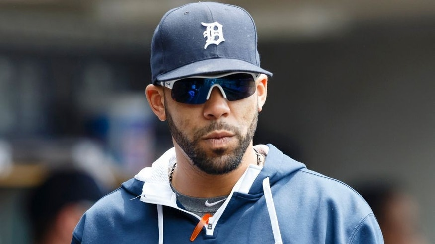 May 9, 2015; Detroit, MI, USA; Detroit Tigers starting pitcher David Price (14) in the dugout before the game against the Kansas City Royals at Comerica Park. Mandatory Credit: Rick Osentoski-USA TODAY Sports