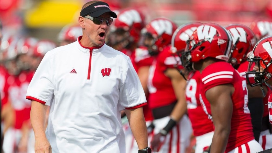 <p>Sep 20, 2014; Madison, WI, USA; Wisconsin Badgers head coach Gary Andersen calls out during warmups prior to the game against the Bowling Green Falcons at Camp Randall Stadium. Mandatory Credit: Jeff Hanisch-USA TODAY Sports</p>