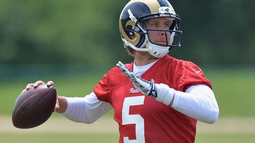 St. Louis Rams quarterback Nick Foles throws a pass during an NFL football organized team activity, Thursday, June 11, 2015, in St. Louis. (AP Photo/Michael Thomas)