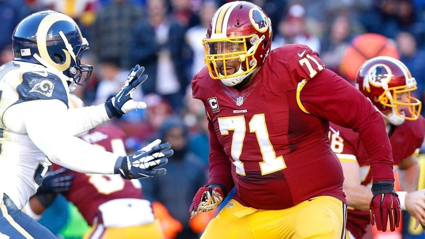 Dec 7, 2014; Landover, MD, USA; Washington Redskins tackle Trent Williams (71) blocks against the St. Louis Rams at FedEx Field. Mandatory Credit: Geoff Burke-USA TODAY Sports