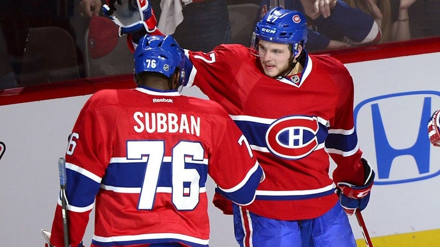Montreal Canadiens' Alex Galchenyuk, right, celebrates with teammate P.K. Subban after scoring on New York Rangers goalie Henrik Lundqvist during the first period of Game 5 of the NHL hockey Stanley Cup playoffs Eastern Conference finals, Tuesday, May 27, 2014, in Montreal. (AP Photo/The Canadian Press, Paul. Chiasson)