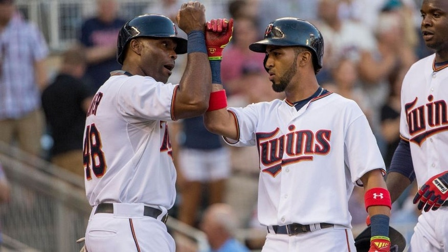 <p>Jul 30, 2015; Minneapolis, MN, USA; Minnesota Twins left fielder Eddie Rosario (20) celebrates with right fielder Torii Hunter (48) after hitting a home run in the first inning against the Seattle Mariners at Target Field. Mandatory Credit: Jesse Johnson-USA TODAY Sports</p>