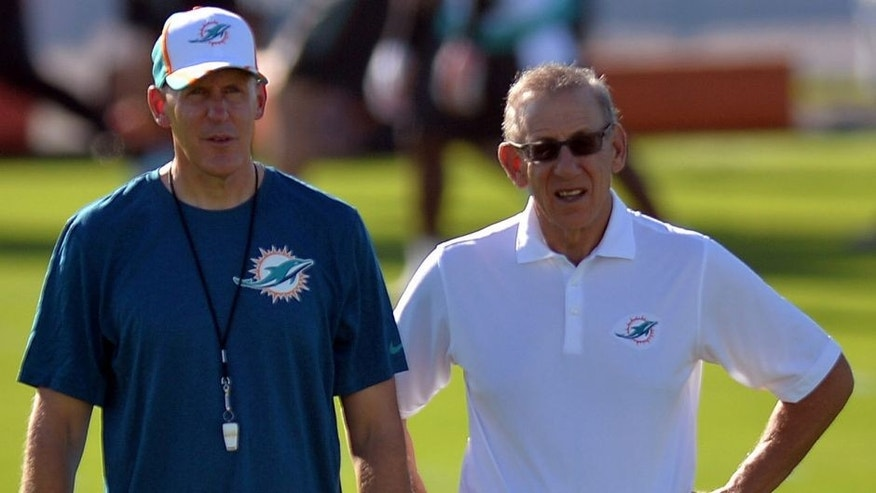 Jul 25, 2014; Davie, FL, USA; Miami Dolphins head coach Joe Philbin (left) talks with the Dolphins owner Stephen Ross (right) at Miami Dolphins Training Facility. Mandatory Credit: Steve Mitchell-USA TODAY Sports