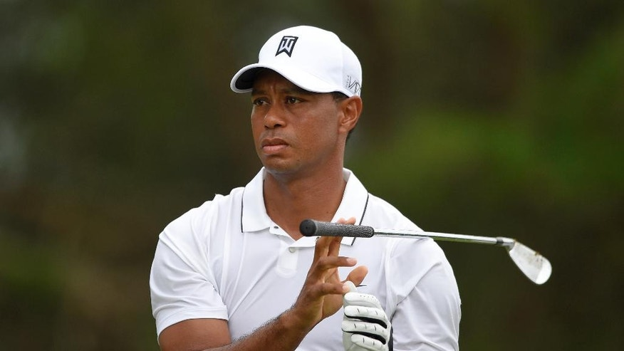 Tiger Woods watches his tee shot on the fourth tee during the first round of the Quicken Loans National Golf tournament at the Robert Trent Jones Golf Club in Gainesville, Va., Thursday, July 30, 2015. (AP Photo/Nick Wass)