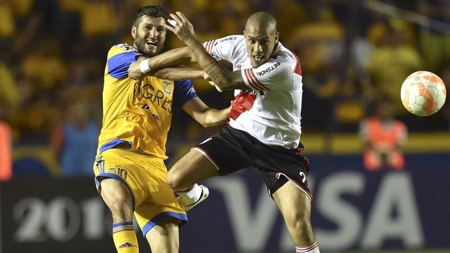 River Plate's Jonathan Maidana (R) vies for the ball with Tigres's Andre Gignac (L) during their Copa Libertadores final match, first leg, at the University stadium in Monterrey, Mexico on July 29, 2015. AFP PHOTO/ Yuri CORTEZ (Photo credit should read YURI CORTEZ/AFP/Getty Images)
