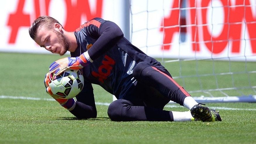 SANTA CLARA, CA - JULY 25: Goalkeeper David De Gea #1 of Manchester United dives for the ball during warm up before the start of International Champions Cup friendly soccer match against FC Barcelona at the Levi's Stadium July 25, 2015 in Santa Clara, California. (Photo by Kevork Djansezian/Getty Images)