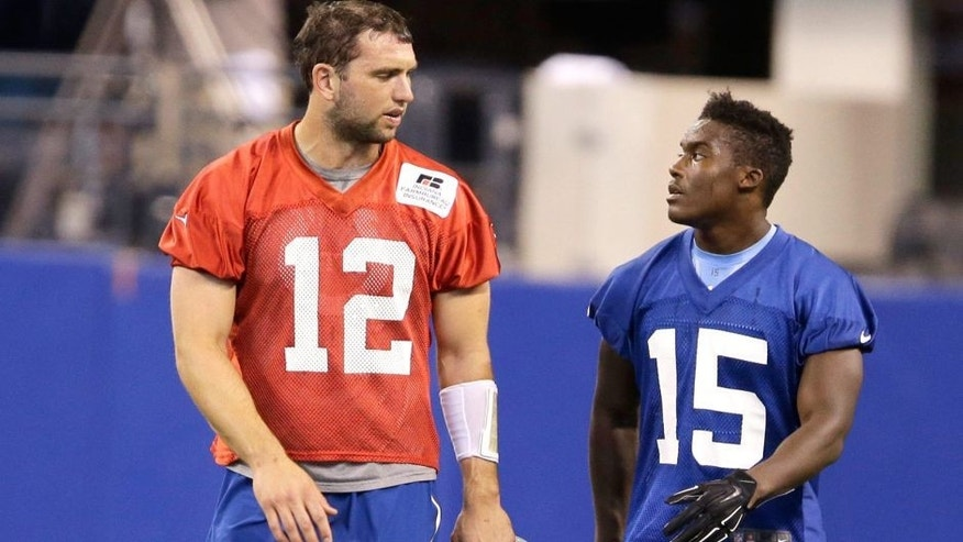 Indianapolis Colts quarterback Andrew Luck (12) talks with Phillip Dorsett during an NFL football organized team activity Wednesday, June 10, 2015, in Indianapolis. (AP Photo/Darron Cummings)