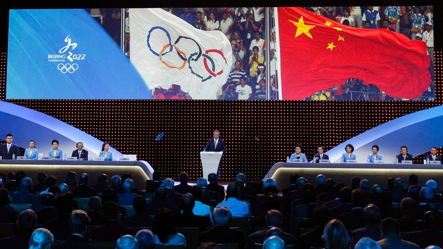 July 31, 2015: Chinese delegation, from left, Yao Ming, Li Nina, Yang Lan, Liu Peng, Yang Yang, Vice President of the China Olympics Council Yu Zaiqing, China Vice Premier Liu Yandong, Wang Anshun, Zhang Haidi, Li Lingwei, Hou Liang and Zhang Li attend the Beijing's bid presentation for the host city for the 2022 Winter Games, at the 128th International Olympic Committee session in Kuala Lumpur, Malaysia