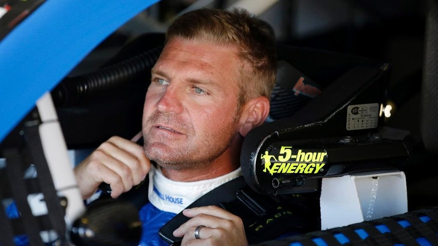 Clint Bowyer sits in his car before a practice session for Sunday's NASCAR Pocono 400 auto race, Friday, July 31, 2015, in Long Pond, Pa. (AP Photo/Matt Slocum)