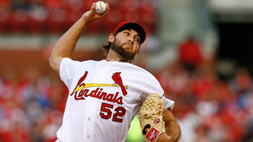 St. Louis Cardinals starting pitcher Michael Wacha throws against the Philadelphia Phillies during the first inning of a baseball game Tuesday, April 28, 2015, in St. Louis. (AP Photo/Billy Hurst)