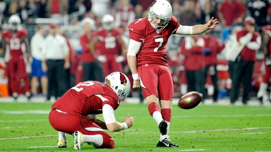 Dec 21, 2014; Glendale, AZ, USA; Arizona Cardinals kicker Chandler Catanzaro (7) kicks a field goal against the Seattle Seahawks during the first half at University of Phoenix Stadium. Mandatory Credit: Joe Camporeale-USA TODAY Sports