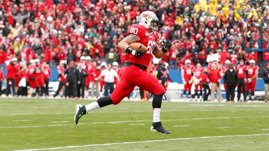 Jan 10, 2015; Frisco, TX, USA; Illinois State Redbirds tight end James O'Shaughnessy (80) runs for a touchdown after catching a pass against the North Dakota State Bison in the third quarter at Pizza Hut Park. Mandatory Credit: Tim Heitman-USA TODAY Sports