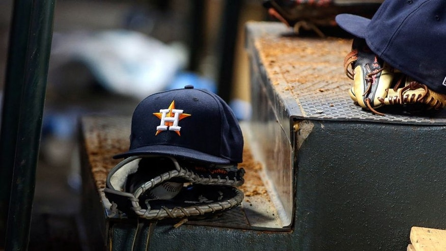 May 4, 2015; Houston, TX, USA; General view of Houston Astros caps and gloves in the dugout during the game against the Texas Rangers at Minute Maid Park. Mandatory Credit: Troy Taormina-USA TODAY Sports