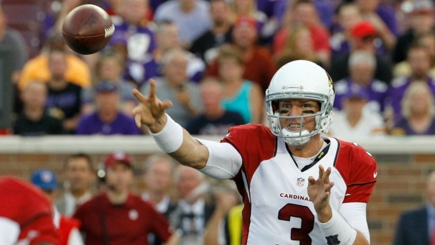 Arizona Cardinals quarterback Carson Palmer throws a pass during the first half of an NFL preseason football game against the Minnesota Vikings, Saturday, Aug. 16, 2014, in Minneapolis. (AP Photo/Ann Heisenfelt)