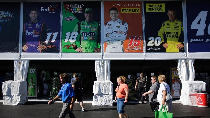 Fans walk through new souvenir superstore behind the grandstands at Pocono Raceway, Friday, July 31, 2015, in Long Pond, Pa. The raceway hosts the NASCAR Pocono 400 auto race on Sunday. (AP Photo/Matt Slocum)