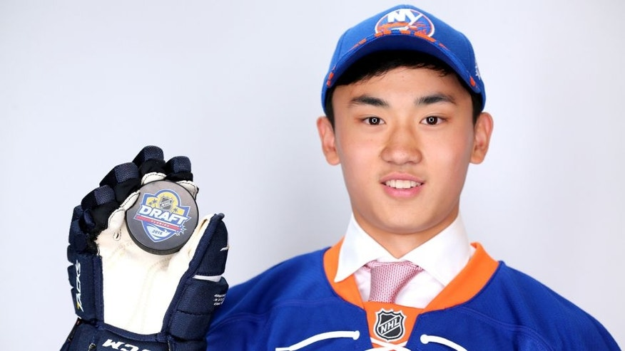SUNRISE, FL - JUNE 27: AnDong Song poses after being selected 172nd overall by the New York Islanders during the 2015 NHL Draft at BB&T Center on June 27, 2015 in Sunrise, Florida. (Photo by Mike Ehrmann/Getty Images)