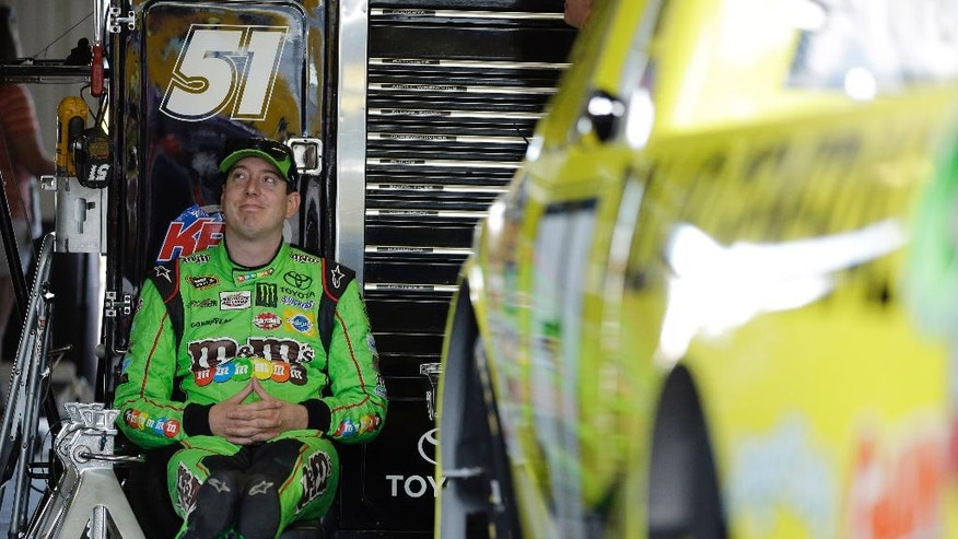 Kyle Busch waits in the garage for the start of a practice session for Saturday's NASCAR truck series Pocono Mountains 150 auto race, Friday, July 31, 2015, in Long Pond, Pa. (AP Photo/Matt Slocum)