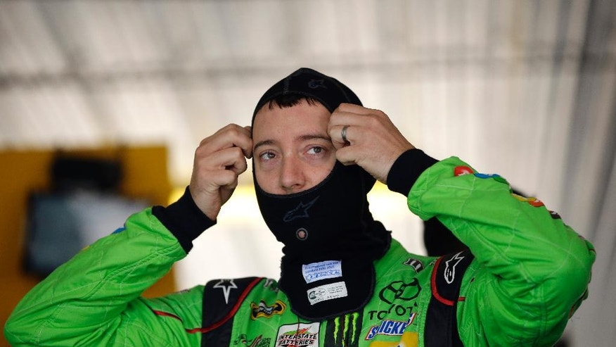 Kyle Busch prepares for a practice session for Sunday's NASCAR Pocono 400 auto race, Friday, July 31, 2015, in Long Pond, Pa. (AP Photo/Matt Slocum)