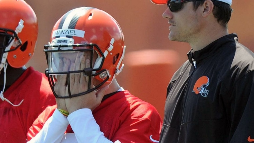 Jun 16, 2015; Berea, OH, USA; Cleveland Browns quarterback Johnny Manziel (2) and quarterbacks coach Kevin O'Connell during minicamp at the Cleveland Browns practice facility. Mandatory Credit: Ken Blaze-USA TODAY Sports